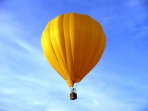 Hot air balloon. Yellow , adventure, sky, clouds, flight, flying Stock Image