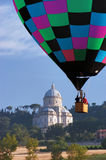 Hot air balloon. In the sky with church on background Royalty Free Stock Photography