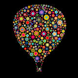 Hot Air Balloon. Vector illustration of Hot Air Balloon shape made up a lot of  multicolored small flowers on the black background Stock Images