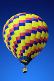 Hot Air Balloon. A hot air balloon against vibrant blue sky Stock Photos