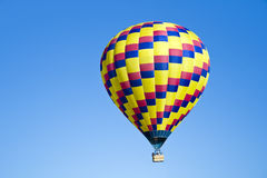 Hot Air Balloon. A hot air balloon against vibrant blue sky Stock Image