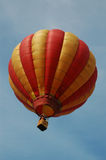 Hot air balloon. A hot air balloon floating in the sky royalty free stock photo