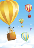 Hot air balloon. Cute little doggie is taking a trip on a colorful hot air balloon. Other balloons are flying in the air on the background. From KidColors series Royalty Free Stock Photo