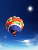 Hot air balloon. In the blue sky Royalty Free Stock Photo