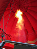 Hot air balloon. Heating up a hot air balloon in flight stock images