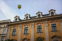 Hot air balloon above Krakow building royalty free stock photo
