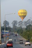 Hot air Balloon above road Stock Image