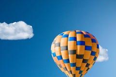 Hot air balloon against brilliant blue sky. Close up stock photo