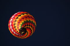 Hot-air balloon against a dark sky. Hot-air balloon against a sky darkened by a polarizing filter Royalty Free Stock Image