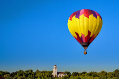 Hot air balloon against a deep blue sky Stock Photo