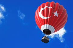 Hot Air Balloon as Turkey Flag. In Flight on a sky background royalty free stock images
