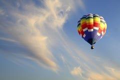 Hot Air Balloon Ascends into Cloudy Sky Stock Photos