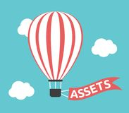 Hot air balloon, assets. Red and white striped hot air balloon with assets text on flag in turquoise blue sky. Money, wealth, investment and savings concept Royalty Free Stock Images