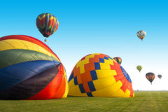 Hot Air Balloon or Balloons, Lots of Colors. Hot air balloons taking off in a field provide lots of colors as they rise toward the sky. Each balloon has its own Royalty Free Stock Photography