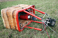 Hot air balloon basket on earth. prepare to fire up the ballooning Royalty Free Stock Photo