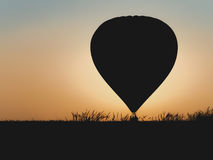Hot air balloon with beautiful sunset background Royalty Free Stock Photography