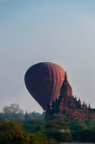 Hot air balloon behind temple in Bagan Stock Photography