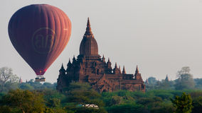 Hot air balloon behind temple in Bagan Stock Photos