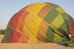 Hot air balloon being deflated on the ground Royalty Free Stock Photography
