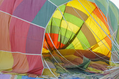 Hot air balloon being deflated on the ground Royalty Free Stock Photo