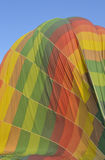 Hot air balloon being deflated on the ground Stock Image