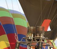 Free Hot Air Balloon Being Inflated In Preparation For Flight. Gas Bu Royalty Free Stock Images - 122984779