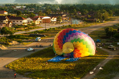 Hot air balloon being inflated in Vang Vieng, Laos Royalty Free Stock Image