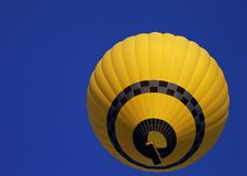 Hot air balloon on blue clear sky Royalty Free Stock Photography