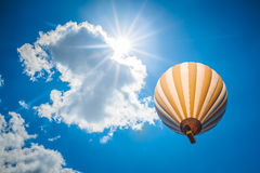 Hot air balloon with blue cloudy sky background Stock Photography