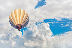 Hot air balloon with blue cloudy sky background Royalty Free Stock Photography