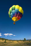 Hot air balloon in the blue sky Stock Photography