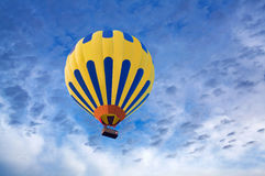 Hot air balloon on blue sky background Royalty Free Stock Image