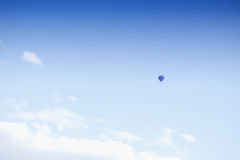 Hot air balloon on blue sky background.  Royalty Free Stock Photos