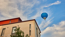 Hot air balloon on blue sky Stock Images