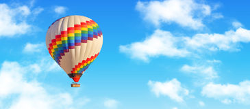 Hot-air balloon. And blue sky and white clouds royalty free stock photo