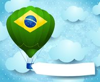 Hot air balloon with Brazilian colors and banner Royalty Free Stock Photo