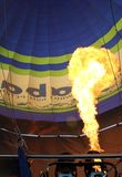 Hot air balloon with bright burning gas flame Royalty Free Stock Photography