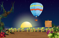 A hot air balloon in a bright full moon Stock Photography
