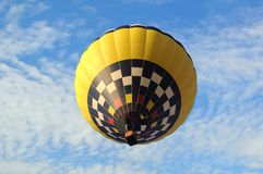 Hot-air balloon on the bsckground of the blue sky. Royalty Free Stock Photography