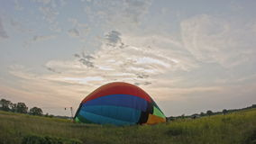 Hot air balloon burner firing and inflates the envelope, time-lapse stock video