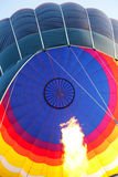 Hot air balloon and burning flame Stock Images