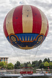 Hot air balloon. Classic style hot air balloon landed with a coudy sky as background Stock Photos