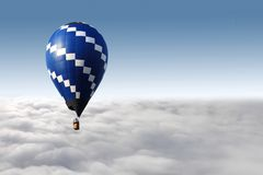Hot air balloon and clouds. Hot air balloon flying over the clouds Royalty Free Stock Photography
