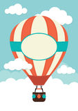 Hot Air Balloon. A hot air balloon in the clouds Stock Photography
