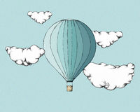 Hot air balloon between clouds Stock Image