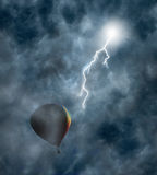 Hot-Air Balloon Among Clouds with Lightning Royalty Free Stock Photo