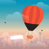 Hot Air Balloon and Clouds. In the sky of a city Stock Images