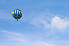Hot Air Balloon in cloudy sky Stock Photo