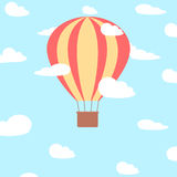 Hot air balloon in the cloudy sky Stock Images