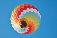 Hot air balloon, colorful aerostat on blue sky Stock Photos